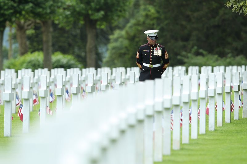 U.S. Marine Sgt. Maj. Darrell Carver of the 6th Marine Regiment walks among the graves of U.S. soldiers killed in World War I at the Aisne-Marne American Cemetery in France on May 27. (Sean Gallup/Getty Images)