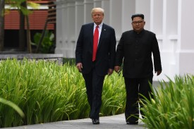 North Korean leader Kim Jong Un (right) walks with U.S. President Donald Trump during a break in talks at their historic U.S.-North Korea summit in Singapore on June 12, 2018. (Saul Loeb/AFP/Getty Images)