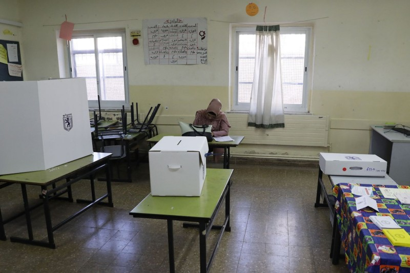 An election official sits in an empty polling station during local elections on October 30, 2018, in the Shuafat neighborhood of East Jerusalem.