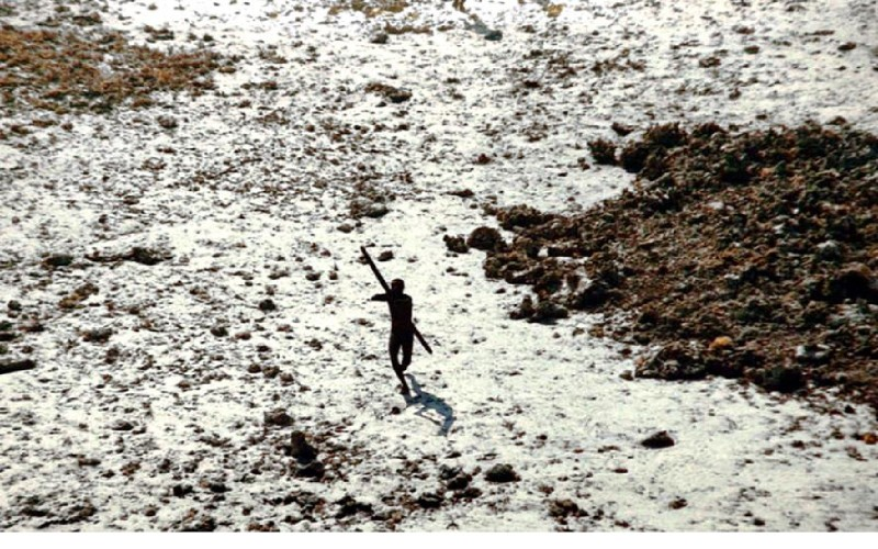A member of the Sentinelese tribe is photographed firing arrows at a helicopter in the wake of the 2004 tsunami. (Indian Coastguard/Survival)