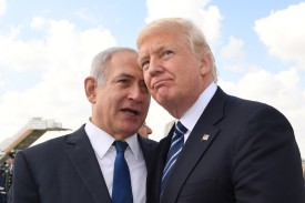 Israeli Prime Minister Benjamin Netanyahu speaks with U.S. President Donald Trump prior to the president's departure from Ben Gurion International Airport in Tel Aviv on May 23, 2017.