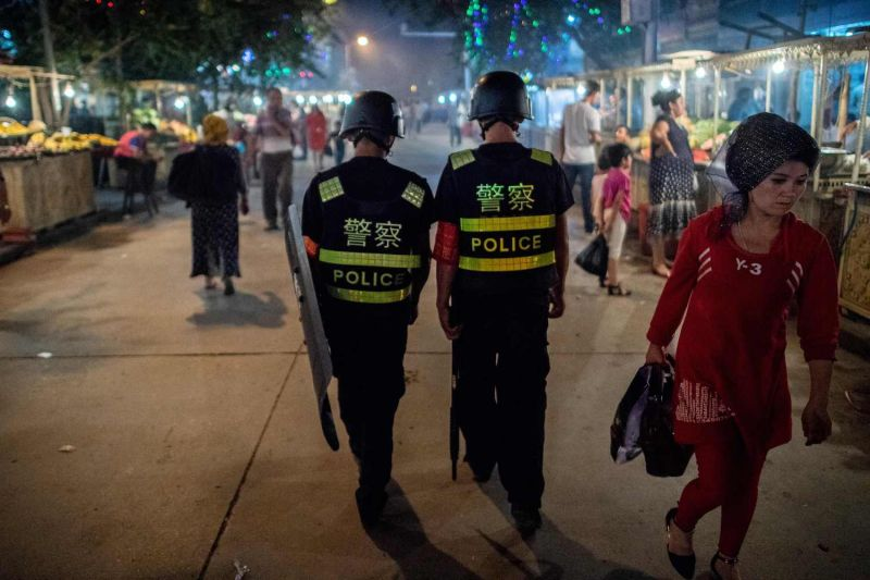 Chinese police patrol a night market near the Id Kah Mosque in Kashgar in China's Xinjiang Uighur Autonomous Region on June 25, 2017, a day before the Eid al-Fitr holiday. (Johannes Eisele/AFP/Getty Images)