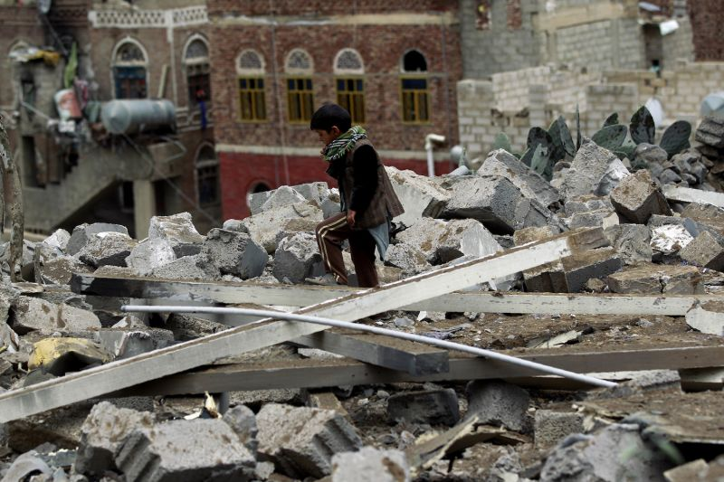 A Yemeni child inspects the rubble of a house in Yemen's rebel-held capital Sanaa on August 11, 2016, after it was reportedly hit by a Saudi-led coalition air strike.