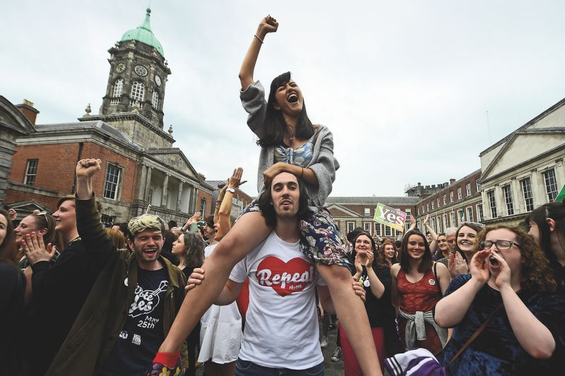 People celebrate the results of the Irish referendum to overturn the country's abortion ban in Dublin on May 26, 2018. (Clodagh Kilcoyne/Reuters)