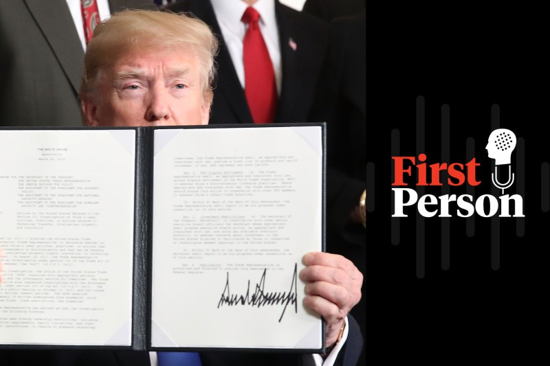 U.S. President Donald Trump holds up a signed presidential memorandum aimed at what he calls Chinese economic aggression at the White House on March 22. (Mark Wilson/Getty Images)