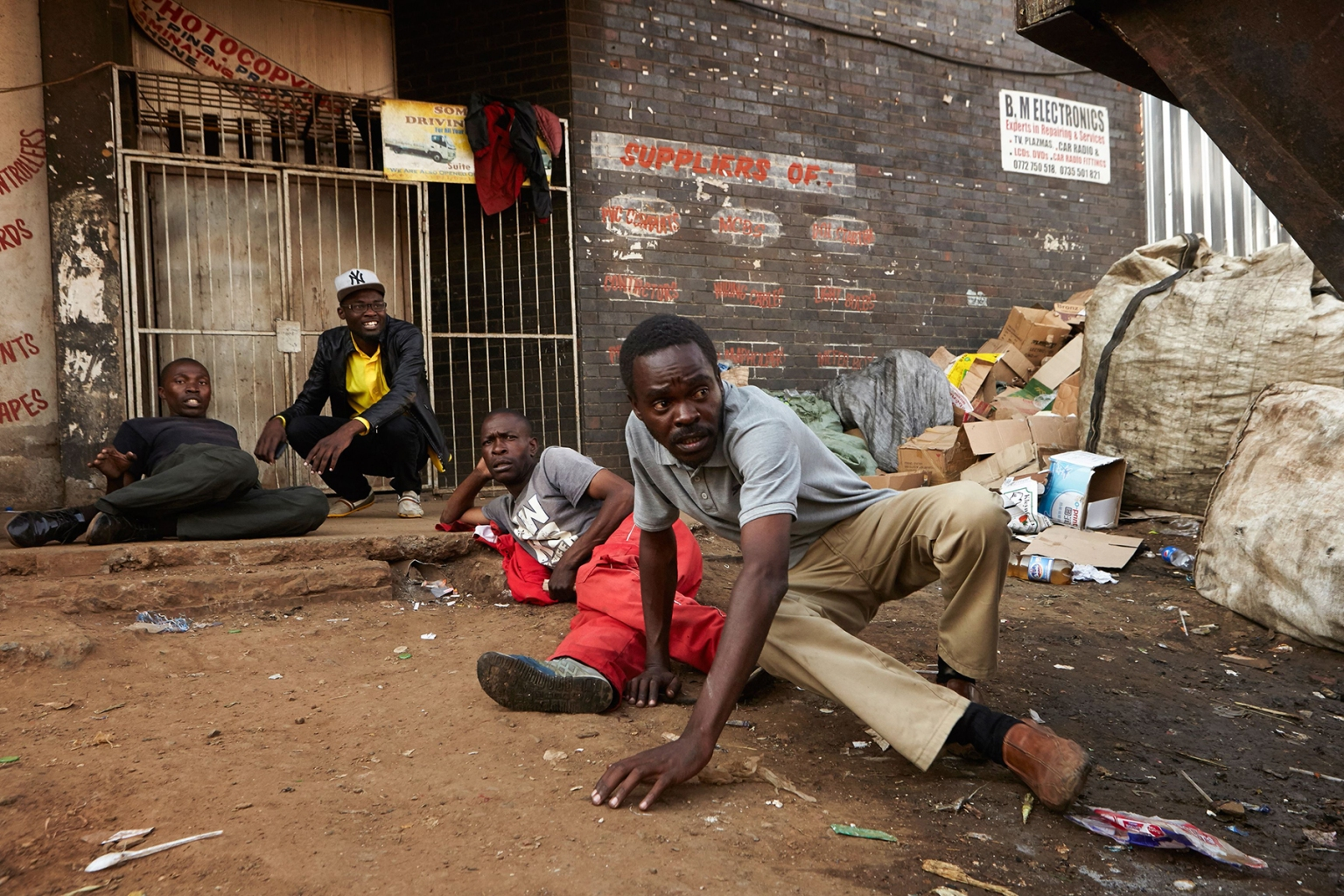 Citizens hide from Zimbabwean soldiers in the streets of Harare on Aug. 1, after protests erupted over alleged fraud in the country's election. ALEX MCBRIDE /AFP/GETTY IMAGES