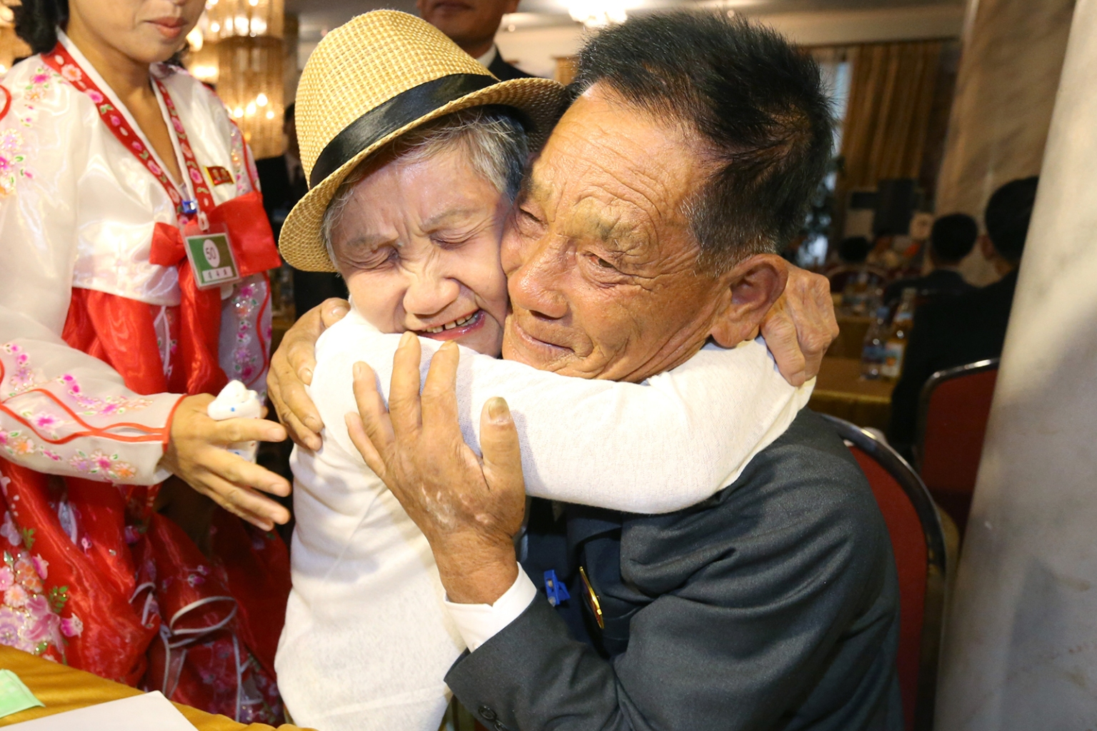 South Korean Lee Keum-seom, 92, embraces her North Korean son Ri Sung Chol, 71, at the Mount Kumgang resort on the North's southeastern coast on Aug. 20. Dozens of elderly South Koreans met their northern relatives for the first time since the peninsula and their families were divided by war nearly seven decades ago. KOREA POOL/AFP/GETTY IMAGES
