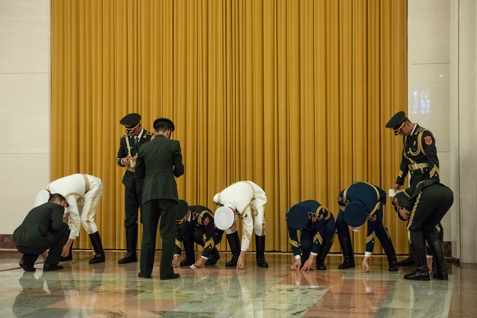 Members of the Chinese People's Liberation Army honor guard prepare for a welcome ceremony for Ivory Coast President Alassane Ouattara at the Great Hall of the People in Beijing on Aug. 30. ROMAN PILIPEY/AFP/GETTY IMAGES