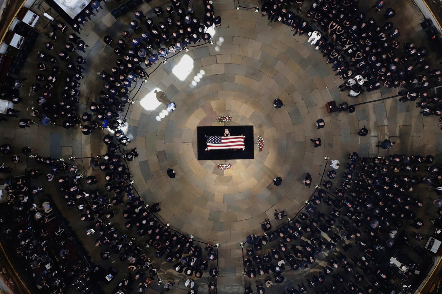 Cindy McCain, wife of the late U.S. Sen. John McCain, stands over his casket as he lies in state in the U.S. Capitol Rotunda in Washington on Aug. 31. MORRY GASH/AFP/Getty Images