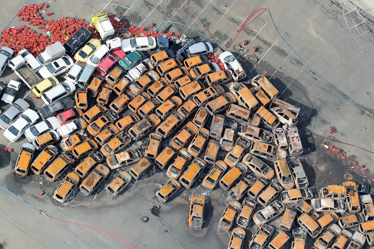 Burned vehicles are piled up after a storm surge and strong winds from typhoon Jebi in Nishinomiya, Japan, on Sept. 5. JIJI PRESS/AFP/Getty Images