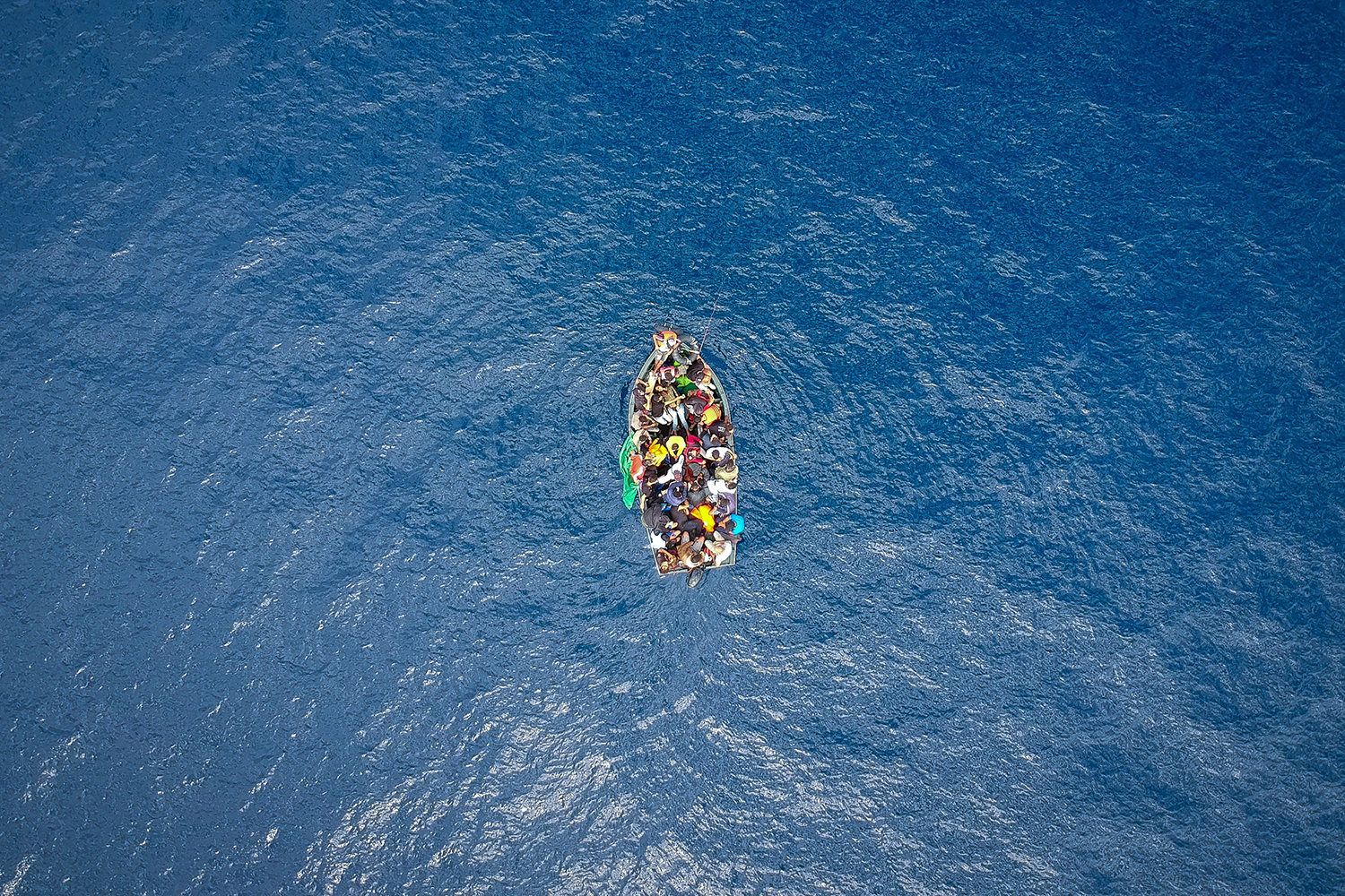 A boat carrying migrants is stranded in the Strait of Gibraltar before being rescued by the Spanish Guardia Civil and the Salvamento Maritimo sea search and rescue agency on Sept. 8. MARCOS MORENO/AFP/Getty Images