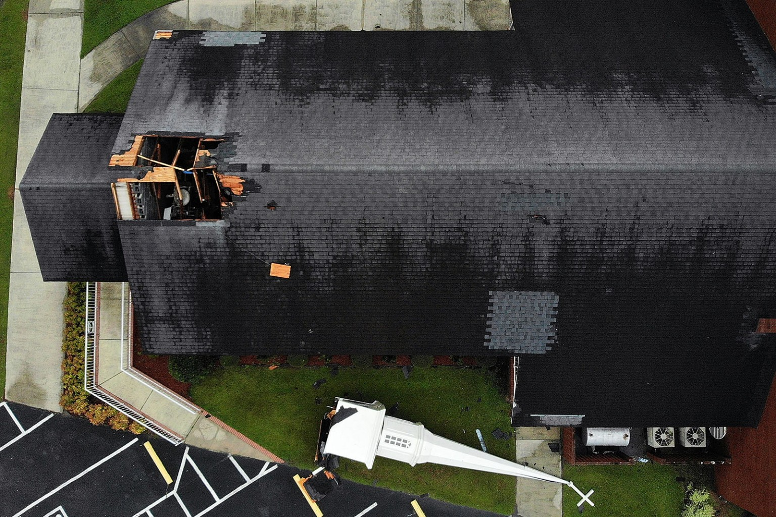 A steeple rests next to the Elah Baptist Church after being blown off by the strong winds of Hurricane Florence in Leland, North Carolina, on Sept. 16. Mark Wilson/Getty Images