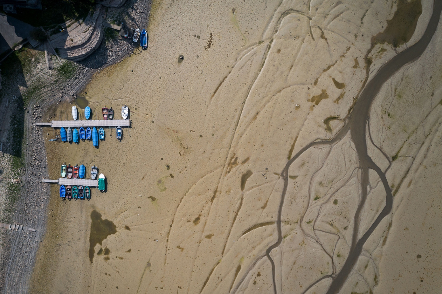Boats sit aground in the dried bed of the Brenet Lake section of the Doubs river, a natural border beetwen eastern France and western Switzerland, on Sept. 20. Upstream, the river dried up due to geological faults that empty the river, accented by a rainless summer. FABRICE COFFRINI/AFP/Getty Images