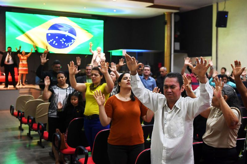 Worshipers at an evangelical church in Brasília, Brazil, on Sept. 21, 2018, pray for the recovery of then-presidential contender Jair Bolsonaro after he was injured in a knife attack. (Evaristo Sa/AFP/Getty Images)