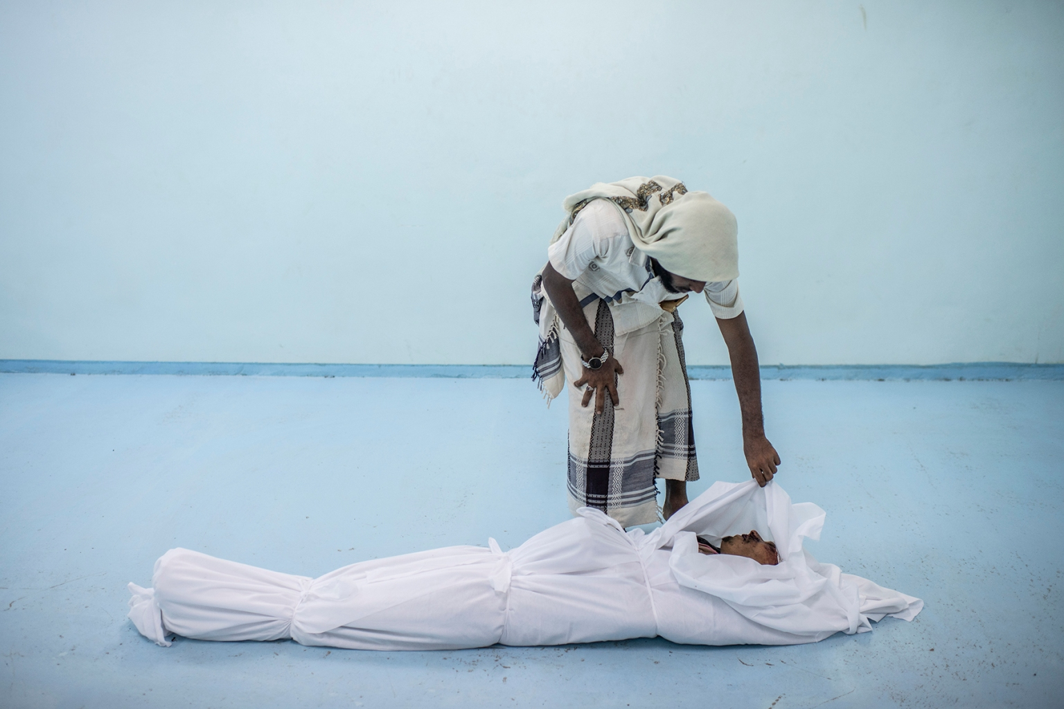 The body of a Yemeni fighter killed in Hodeidah is attended to by a friend at the morgue of a field hospital in Al Khawkhah, Yemen, on on Sept. 22. Andrew Renneisen/Getty Images