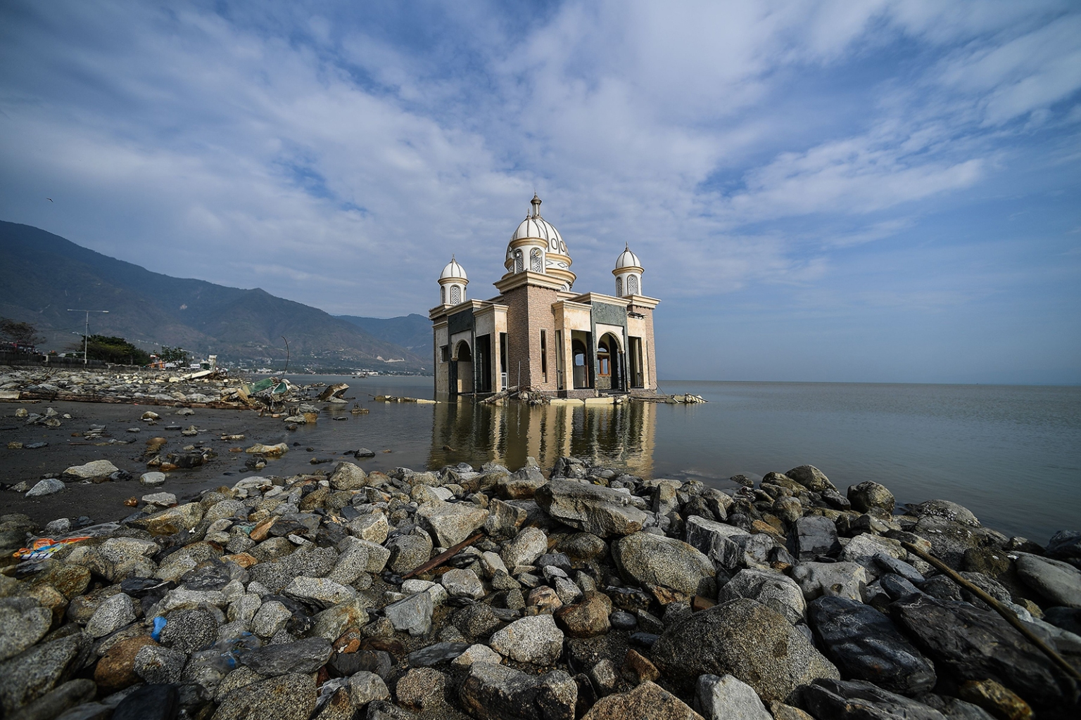 A damaged mosque is seen by the tsunami-devastated coast in Palu, Indonesia, on Oct. 4. MOHD RASFAN/AFP/GETTY IMAGES