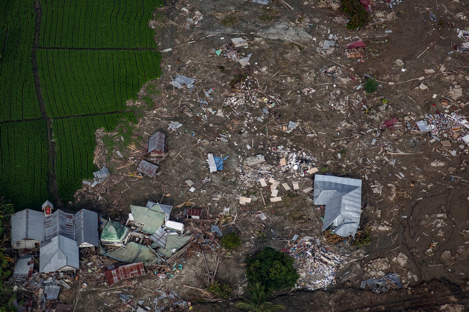Destroyed houses and debris cover fields following the earthquake and tsunami in Central Sulawesi, Indonesia, on Oct. 4. Ulet Ifansasti/Getty Images