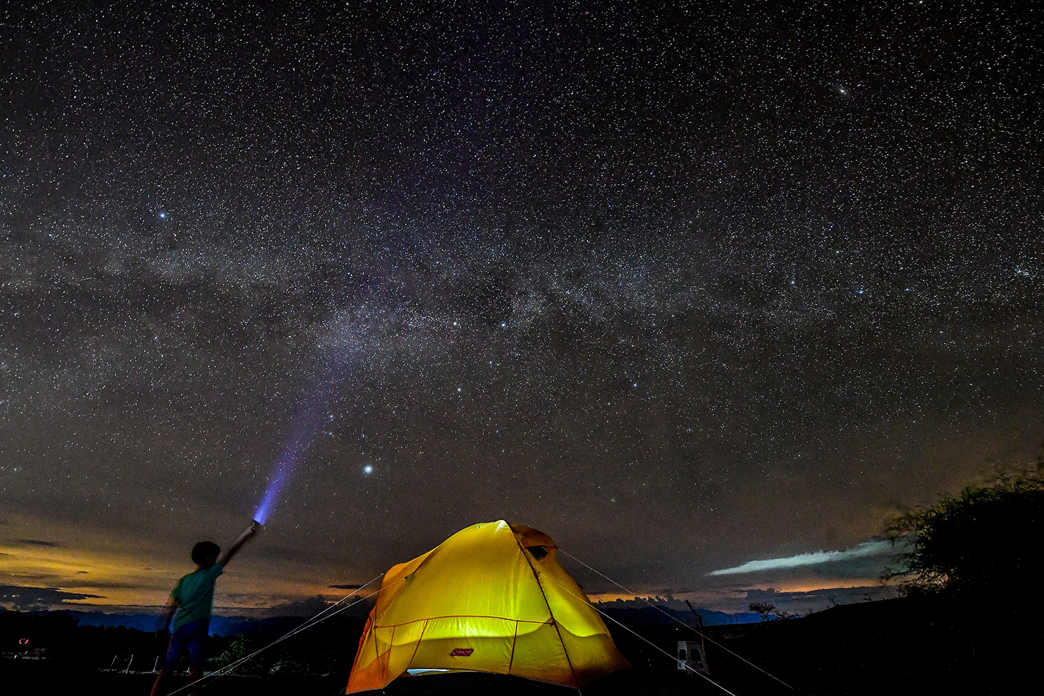 A boy adds to the light show from the Milky Way in the sky over the Tatacoa Desert in Huila, Colombia, on Oct. 11. LUIS ACOSTA/AFP/GETTY IMAGES