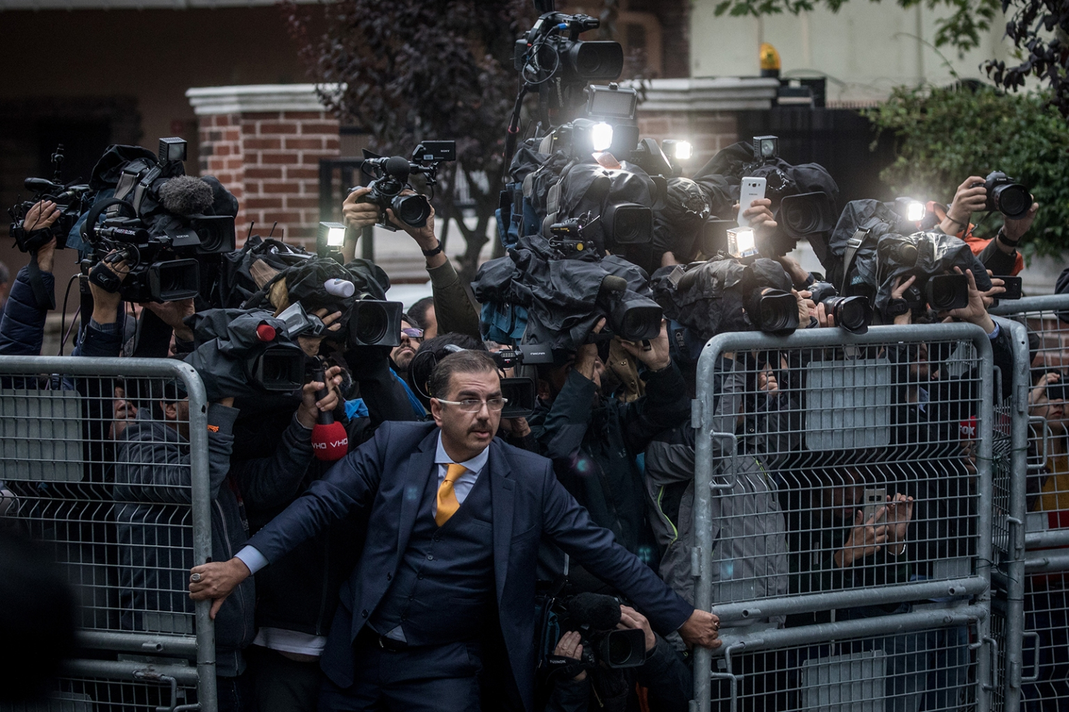 A man tries to hold back the press as Saudi investigators arrive at the Saudi Arabian consulate ahead of Turkish police on Oct. 22 amid a growing international backlash to the disappearance—later determined to be the killing—of journalist Jamal Khashoggi in Istanbul. Chris McGrath/Getty Images