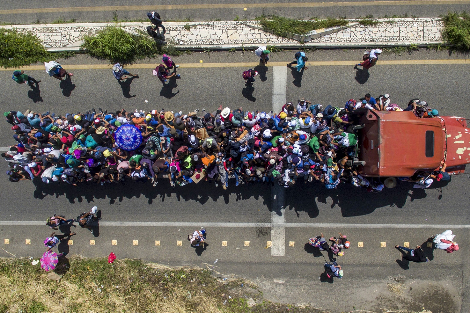 Honduran migrants crowd a truck as they head through Huixtla, in Chiapas state, Mexico, en route to the United States on Oct. 22. PEDRO PARDO/AFP/Getty Images