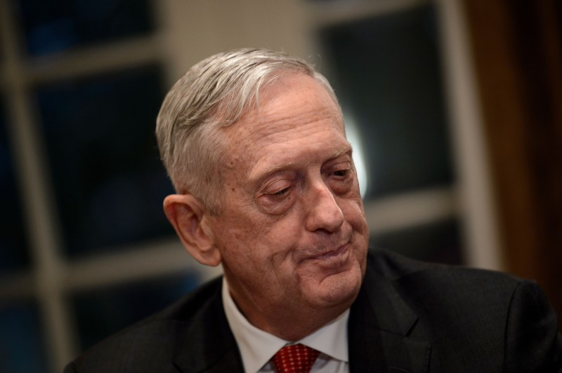 Then-Secretary of Defense James Mattis listens while President Donald Trump speaks before a meeting with military leaders in the White House in Washington on Oct. 23, 2018. (Brendan Smialowski/AFP/Getty Images)