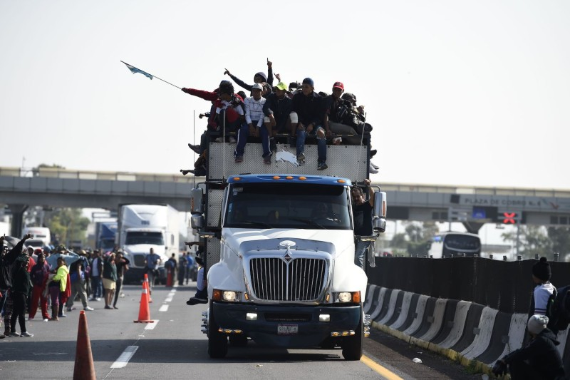 Central American migrants—mostly Honduran—taking part in a caravan to the United States through central Mexico on Nov. 11.(Alfredo Estrella/AFP/Getty Images)