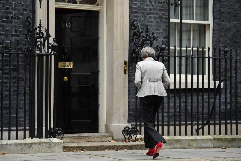 Britain's Prime Minister Theresa May returns to 10 Downing Street in central London after making a statement following the announcement of a draft deal on post-Brexit trade ties with the EU on Nov. 22. (Ben Stansall/AFP/Getty Images)