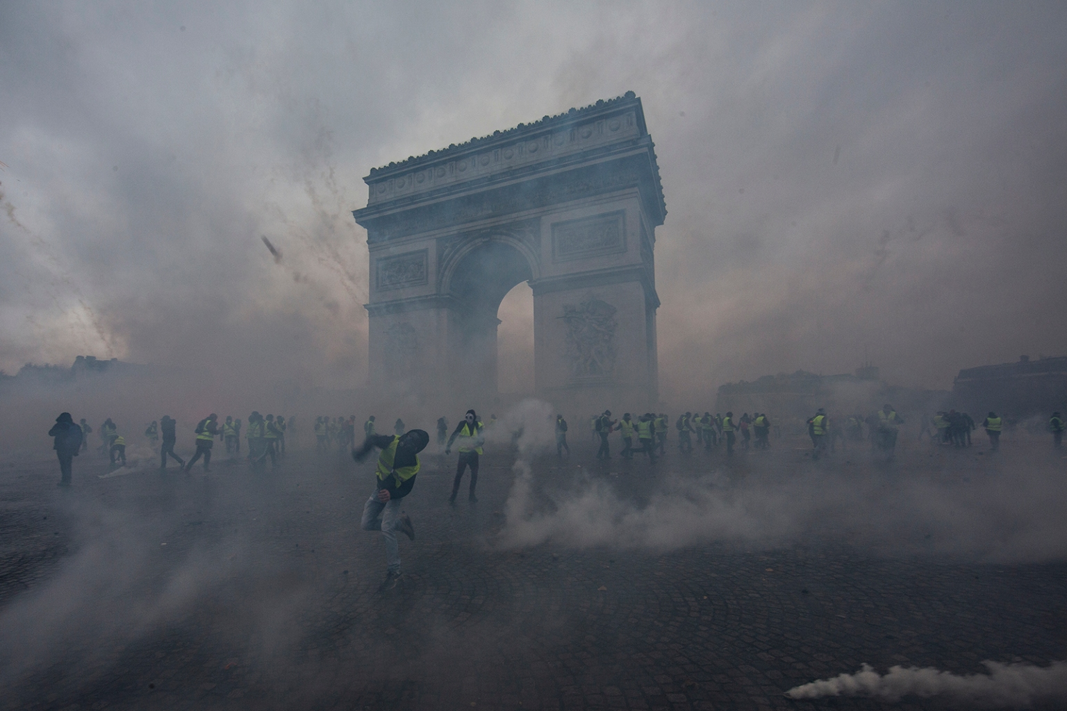 Teargas surrounds protesters as they clash with riot police during a Yellow Vest demonstration near the Arc de Triomphe in Paris on Dec. 1. Veronique de Viguerie/Getty Images
