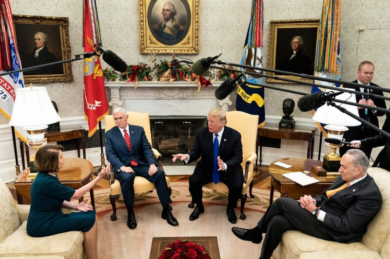 U.S. Vice President Mike Pence and Senate Minority Leader Charles E. Schumer listen while the presumptive House Speaker, Nancy Pelosi, and U.S. President Donald Trump argue while making statements to the press before a meeting at the White House December 11, 2018 in Washington, DC.  BRENDAN SMIALOWSKI/AFP/Getty Images