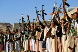 Armed Houthi separatists brandish their weapons as they gather in the capital Sanaa on Dec. 13.   (Photo credit: Mohammed Huwais/AFP/Getty Images)