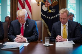 President Donald Trump and Deputy Secretary of Defense Patrick Shanahan, bow their heads in prayer before the start of a Cabinet meeting of the White House in Washington on Aug. 18. (Mandel Ngan/AFP/Getty Images)