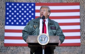 U.S. President Donald Trump speaks to members of the U.S. military during an unannounced trip to Al Asad Airbase in Iraq on Dec. 26, 2018. (Saul Loeb/AFP/Getty Images)