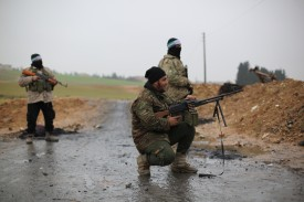 Members of a Turkey-backed Syrian militia near the Northern Syrian city of Manbij, on Dec. 30. (Anas Alkharboutli/Picture Alliance/ Getty Images)