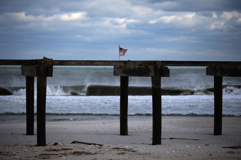 An American flag is attached to the boardwalk damaged by Superstorm Sandy, on Nov. 24, 2012 in Ortley Beach, New Jersey.  (Mark Wilson/Getty Images)