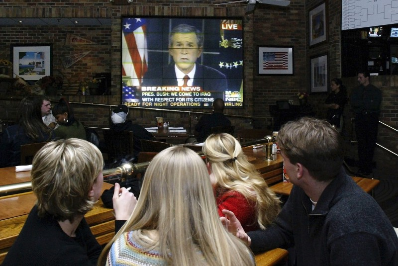 Americans watch President George W. Bush address the nation on March 19, 2003 in Marlton, New Jersey.  (Don Murray/Getty Images)