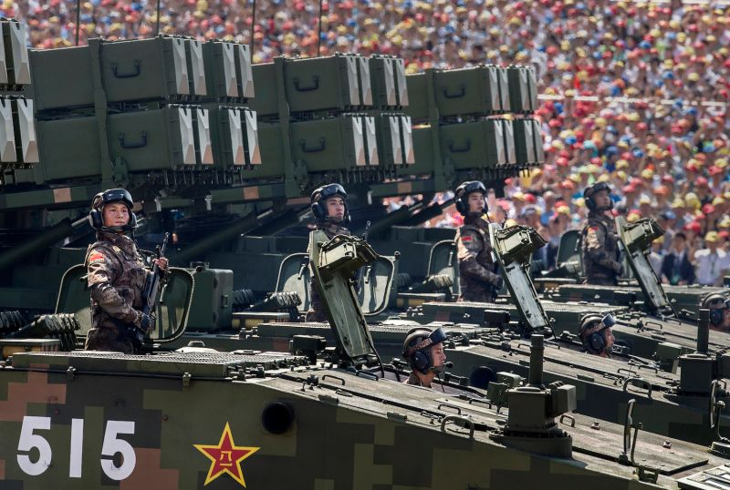 Chinese soldiers ride on armored missile carriers as they pass in front of Tiananmen Square and the Forbidden City during a military parade on Sept. 3, 2015, in Beijing. (Kevin Frayer/Getty Images)