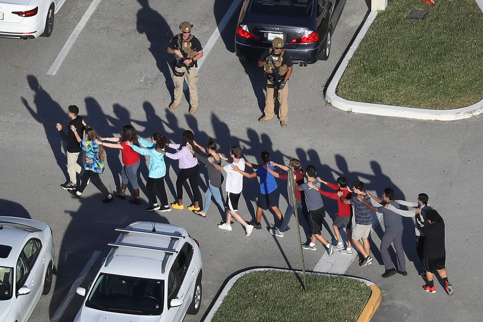 Students are brought out of Marjory Stoneman Douglas High School in Parkland, Florida, after a shooter at the school killed 17 people on Feb. 14. Joe Raedle/Getty Images