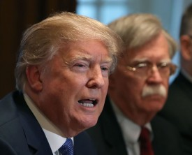 U.S. President Donald Trump is flanked by National Security Advisor John Bolton as he speaks about the FBI raid at his lawyer Michael Cohen's office in Washington, D.C., on April 9. (Mark Wilson/Getty Images)