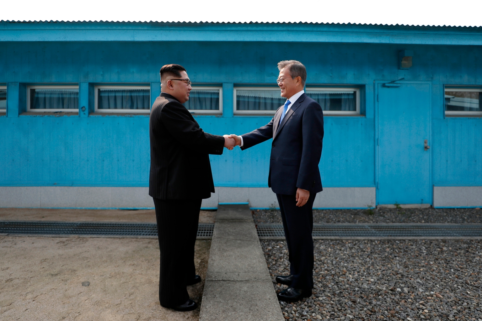North Korea's leader Kim Jong Un shakes hands with South Korea's President Moon Jae-in at the Military Demarcation Line that divides their countries ahead of their summit at Panmunjom on April 27. KOREA SUMMIT PRESS POOL/AFP/Getty Images