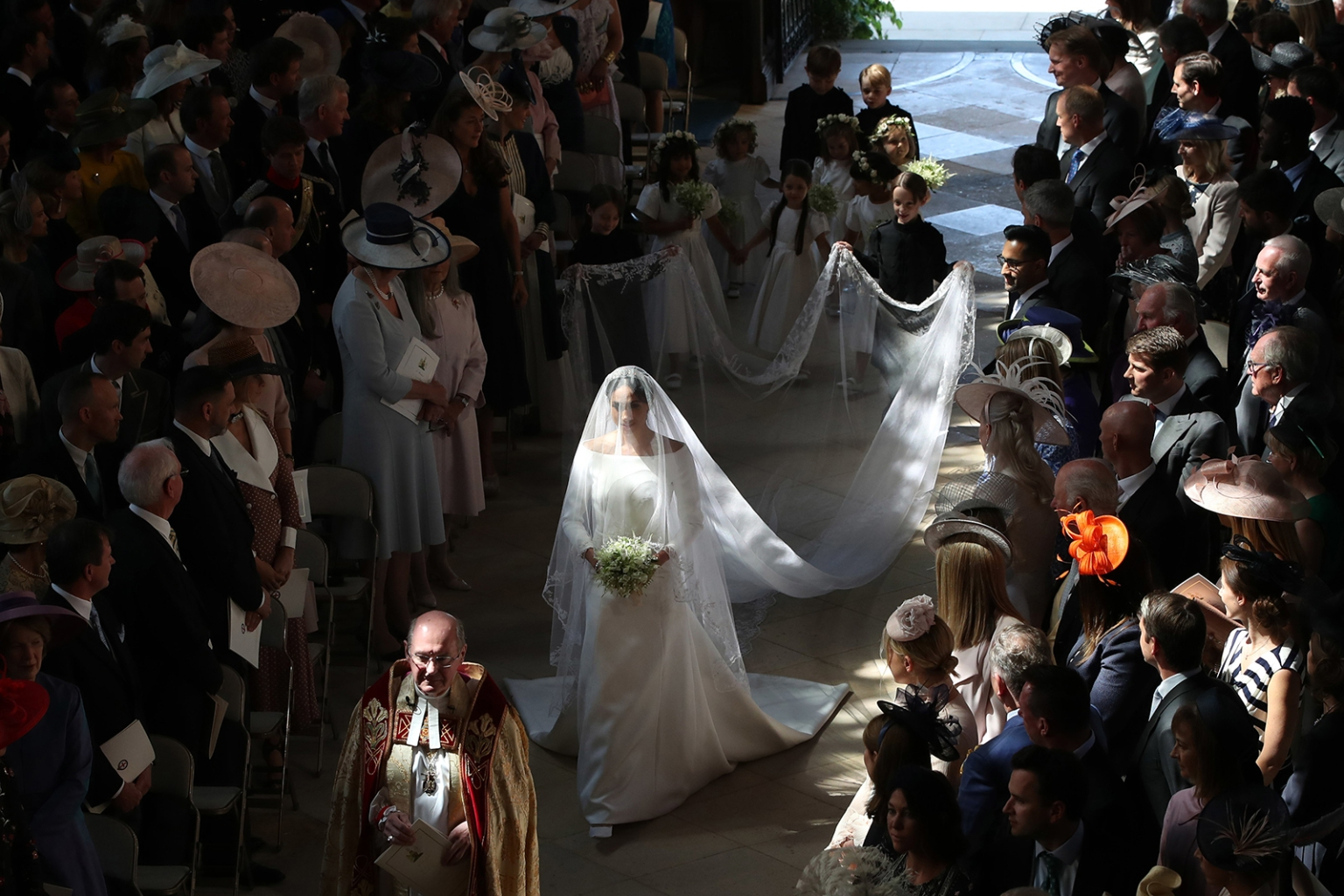 Meghan Markle walks down the aisle of St George's Chapel at Windsor Castle for her wedding to Britain's Prince Harry in Windsor, England, on on May 19. Danny Lawson/Getty Images