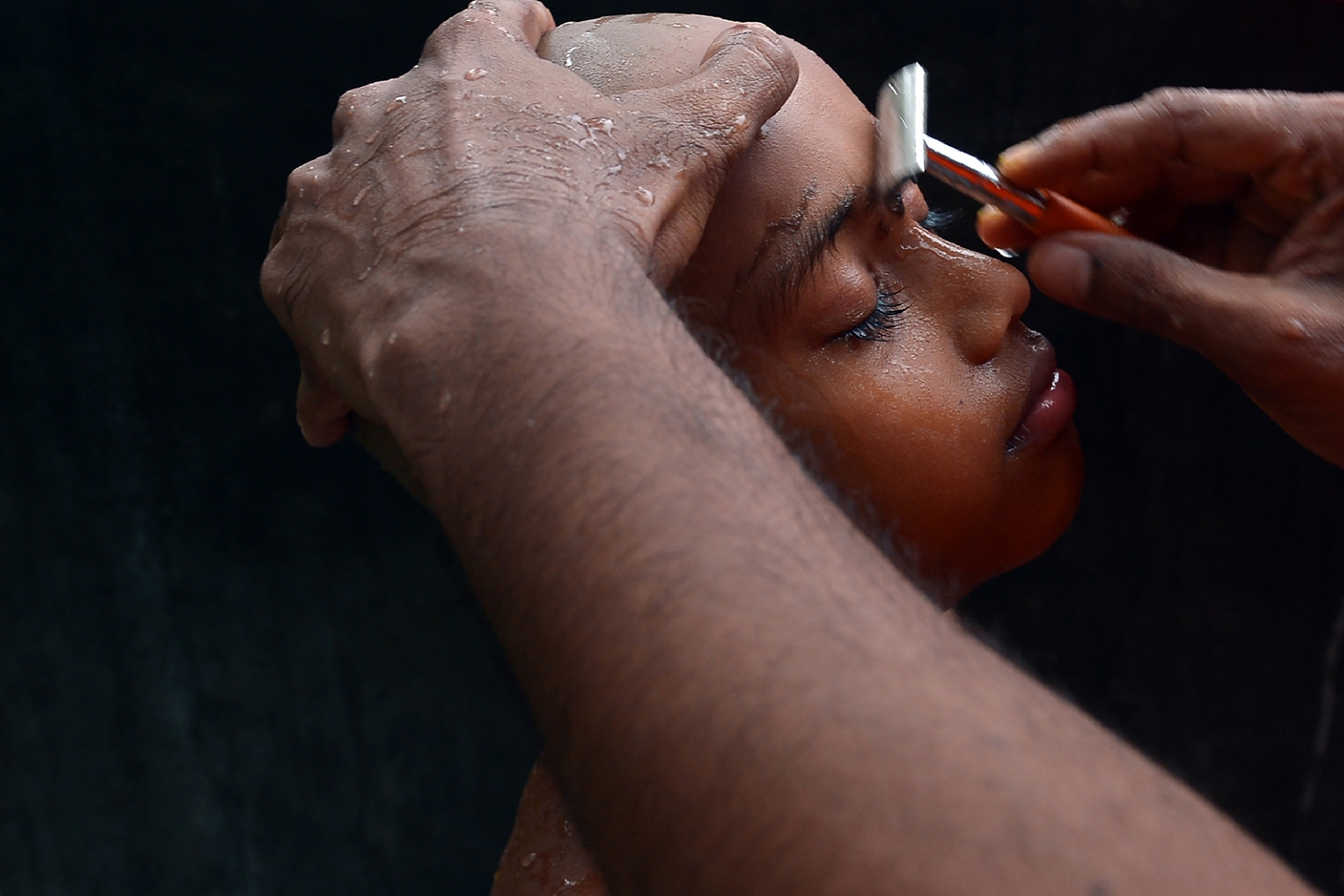 A Sri Lankan novice monk has his eyebrows shaved during a ceremony marking entry into the priesthood in the village of Eheliyagoda, Sri Lanka, on May 28. Sri Lanka is primarily a Buddhist country but faces a shortage of men joining the priesthood. LAKRUWAN WANNIARACHCHI/AFP/GETTY IMAGES