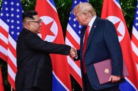 North Korea leader Kim Jong Un and U.S. President Donald Trump shake hands after meeting at the Capella resort on Sentosa Island in Singapore on June 12. The pair became the first sitting U.S. and North Korean leaders to meet. SUSAN WALSH/AFP/Getty Images