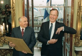 George Bush laughs with Soviet President Mikhail Gorbachev on Sept. 9, 1990 after their first meeting at the Presidential Palace in Helsinki, Finland. (Mike Sargent/AFP/Getty Images)