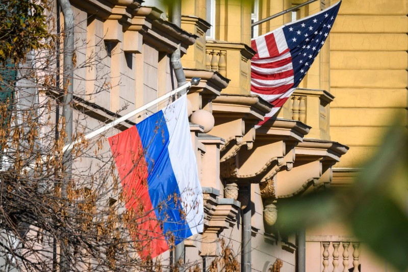 A Russian flag flies next to the U.S. Embassy building in Moscow on Oct. 22. (Mladen Antonov/AFP/Getty Images)