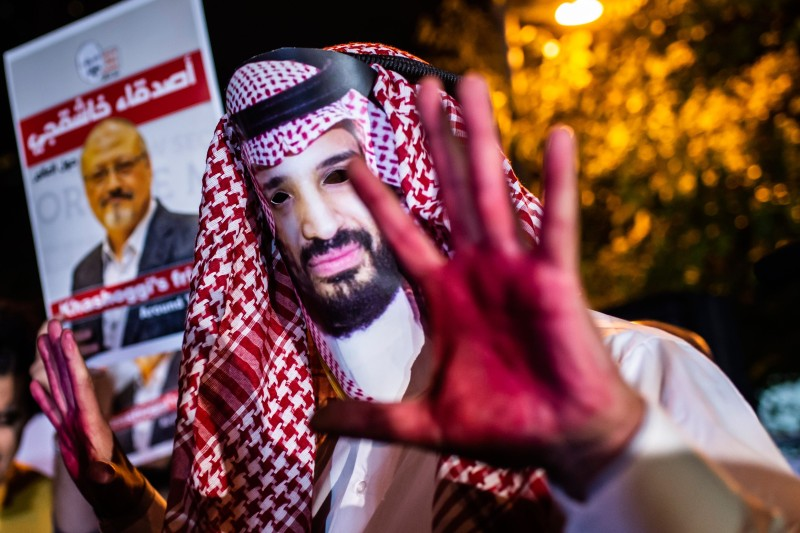 A protester wears a mask depicting Saudi Crown Prince Mohammed bin Salman outside the Saudi Arabian consulate in Istanbul on Oct. 25. (Yasin Akgul/AFP/Getty Images)
