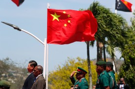 Chinese President Xi Jinping, Papua New Guinea's Governor-General Bob Dadae, and Papua New Guinea's Chief of Defense Gilbert Toropo attend a welcome ceremony for Xi's state visit in Port Moresby on Nov. 16. (David Gray/AFP/Getty Images)