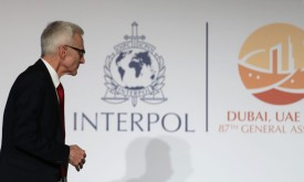 Jürgen Stock, the secretary-general of Interpol, is seen walking as he gives a press conference in Dubai on Nov. 21. (Karin Sahib/AFP/Getty Images)