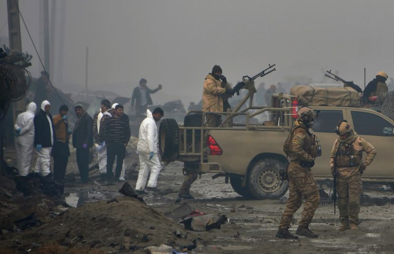 Afghan security forces and investigators gather at the site of a suicide bomb attack outside a British security firm's compound in Kabul, a day after the blast on November 29, 2018.  (NOORULLAH SHIRZADA/AFP/Getty Images)