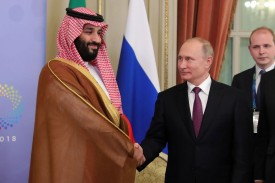 This week's OPEC+ meeting could see another friendly handshake between Saudi Arabian Crown Prince Mohammed bin Salman and Russian President Vladimir Putin, pictured here on Dec. 1. (Mikhail Klimentyev/AFP/Getty Images)