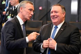 U.S. Secretary of State Mike Pompeo, right, and NATO Secretary-General Jens Stoltenberg talk during a NATO foreign ministers meeting at the NATO headquarters in Brussels on Dec. 4. (John Thys/AFP/Getty Images)